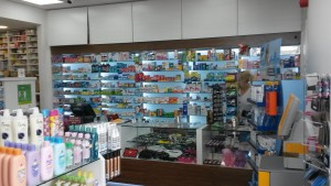 retail pharmacy cosmetics counter, backlit glass shelving